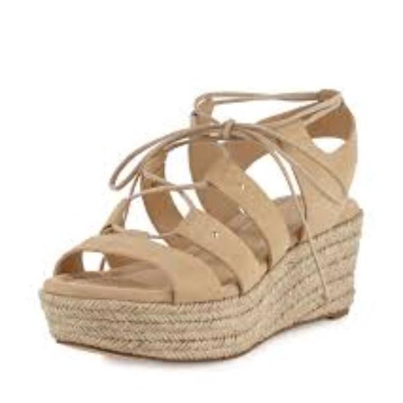 2cfb1bb46df Michael Kors Sofia Lace Up Mid Wedge Sandal. M 5a8632b361ca10a1a15f597b